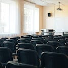 Empty school assembly hall for meetings and presentations, school education.